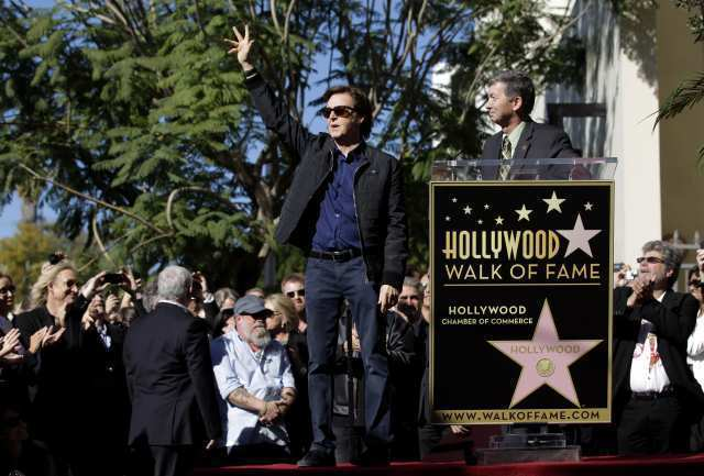 Former Beatle Paul McCartney waves during his 2012 Hollywood Walk of Fame ceremony as he is introduced by Leron Gubler, CEO of the Hollywood Chamber of Commerce.