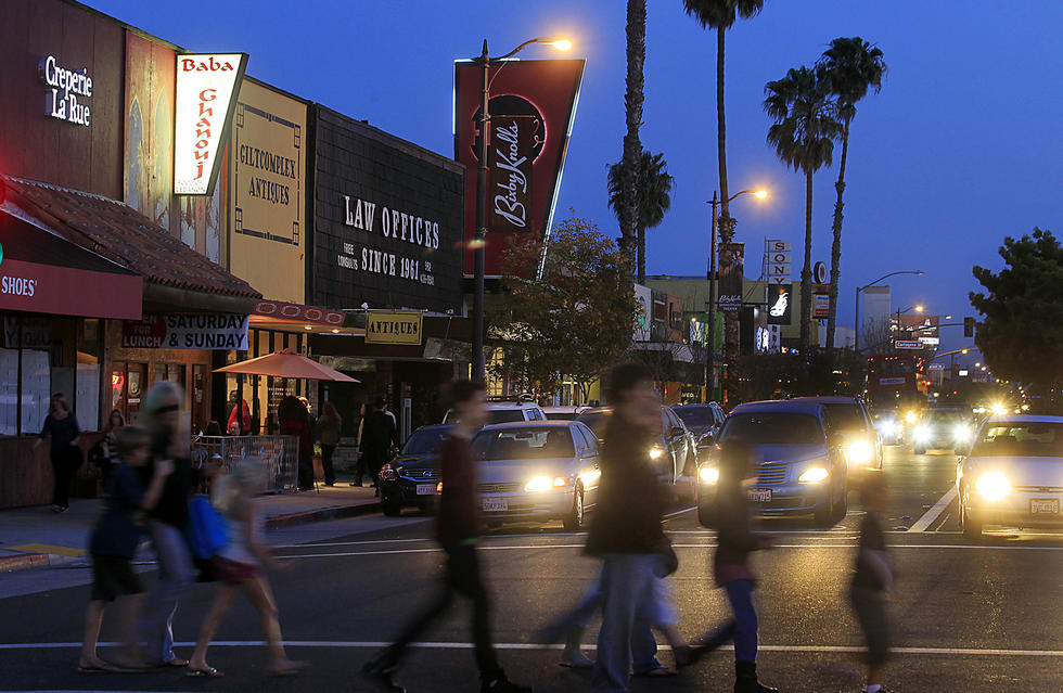 Pedestrians stroll along Atlantic in Bixby Knolls during the latest of the Long Beach neighborhood's monthly