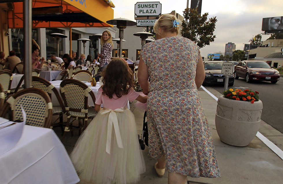 Caption: Sunset Plaza on the Strip is the place for window shopping, dressing up and dining. (Luis Sinco / Los Angeles Times)