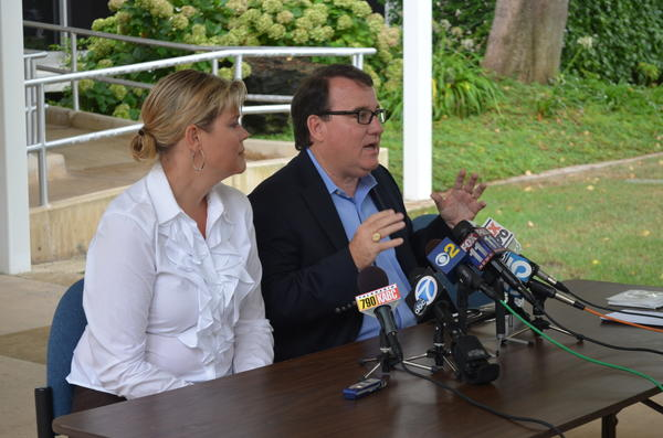 Costa Mesa Mayor Pro Tem Jim Righeimer and his wife, Lene, at a press conference at City Hall on Friday.