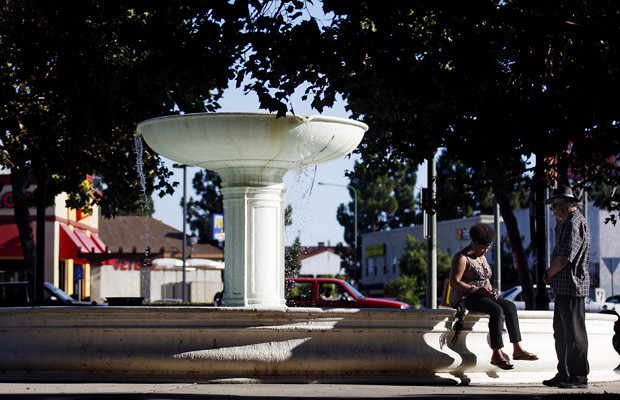 The fountain at Leimert Park Plaza makes a relaxing lounging spot. The park was designed between 1926 and 1928 by the Olmsted Bros. firm, led by sons of the Central Park designer Frederick Law Olmsted. (Luis Sinco / Los Angeles Times)