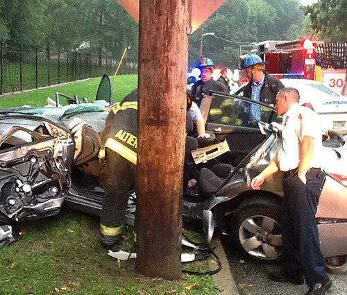 Driver Strikes Utility Pole On Rain-covered Road