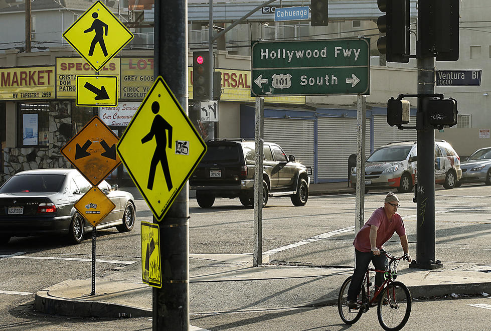 All types of signs dominate the landscape at the intersection of Lankershim, Ventura and Cahuenga boulevards in Studio City. (Luis Sinco / Los Angeles Times)