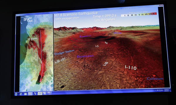 A computer-generated graphic is displayed at a news conference in Pasadena to announce legislation to create an earthquake early warning system for California. The graphic shows the progression of earthquake shock waves along the San Andreas Fault, from the Salton Sea to downtown Los Angeles.