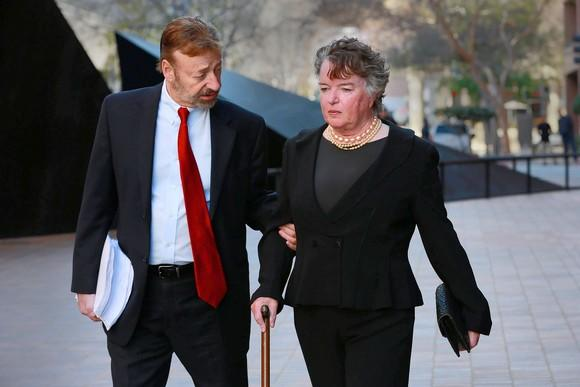 Maureen O'Connor walks to court with her attorney