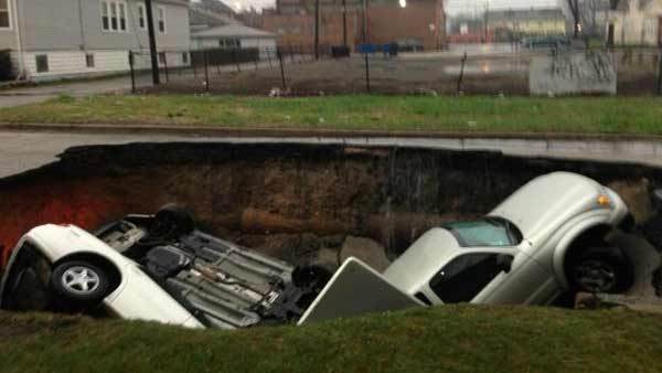 A sinkhole swallowed three cars in the 9600 block of South Houston Avenue in the South Deering neighborhood.