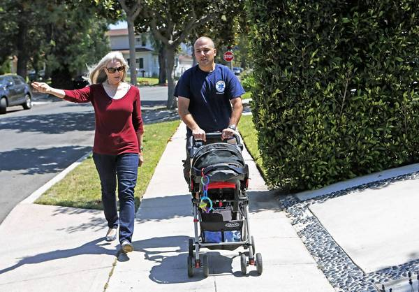 Colleen Mason Heller, who heads the Cheviot Hills Homeowners Assn., walks the neighborhood with Gregg Spiegelman and his baby, Drew. (Anne Cusack / Los Angeles Times / July 24, 2013)