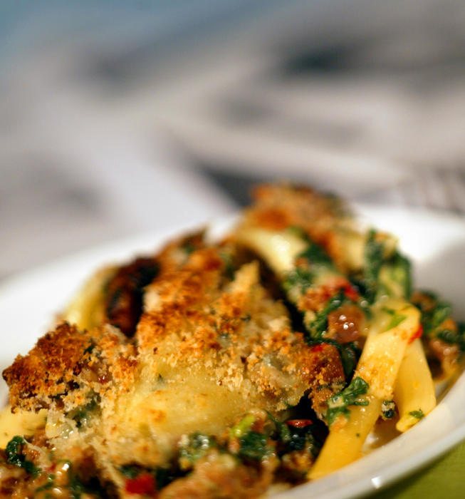 Baked pasta with spinach and sausage