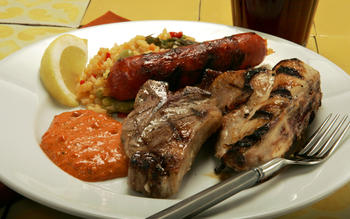 Grilled rabbit, lamb and chorizo with romesco sauce