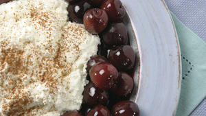 Homemade ricotta with red wine-poached cherries
