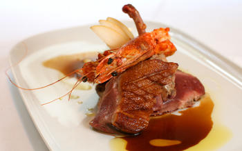 Roast duck with seared prawns