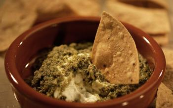 Queso de chiva fundido con pipian verde (Broiled goat cheese with pumpkin seed sauce)