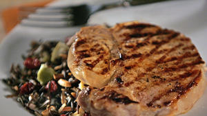 Cider-brined pork chops with wild rice