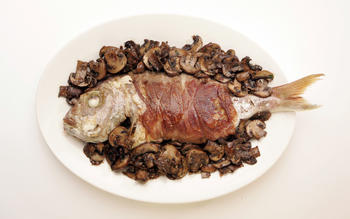 Pan-roasted fish with prosciutto and mushrooms