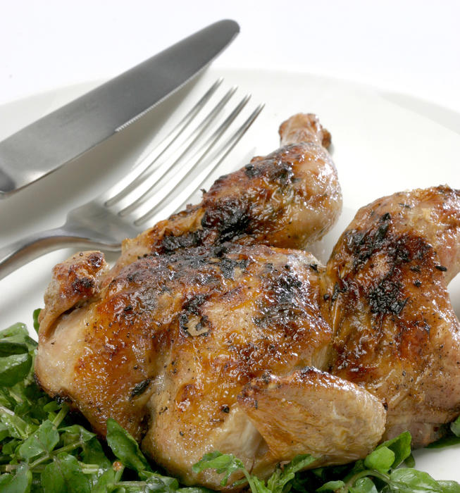 Spring chicken with ramps on a bed of watercress