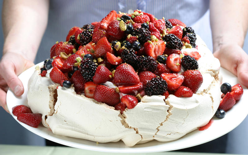 Berry Pavlova with vanilla whipped cream and pistachios