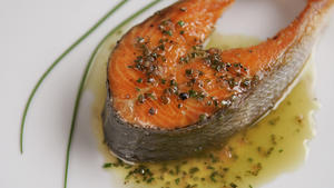 Pan-seared wild salmon steaks with chive vinaigrette