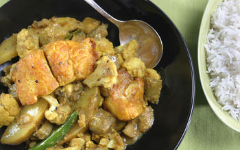 Maacher jhol (Bengali fish curry with eggplant, cauliflower and potato)