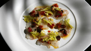 Sea bass with celery leaves and sun-dried tomato confit
