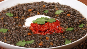 Beluga lentil soup with tomato-pepper harissa