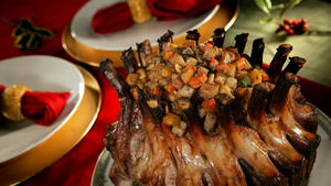 Spiced crown pork roast with glazed root vegetables