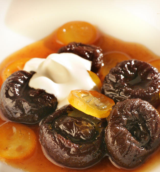 Earl Grey tea-poached prunes with glazed kumquats