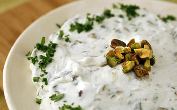 Yogurt cheese seasoned with olives, capers and pistachios
