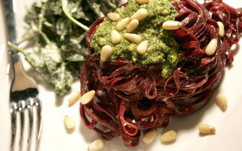 Cilantro pesto beet fettuccine with arugula and cream dressing