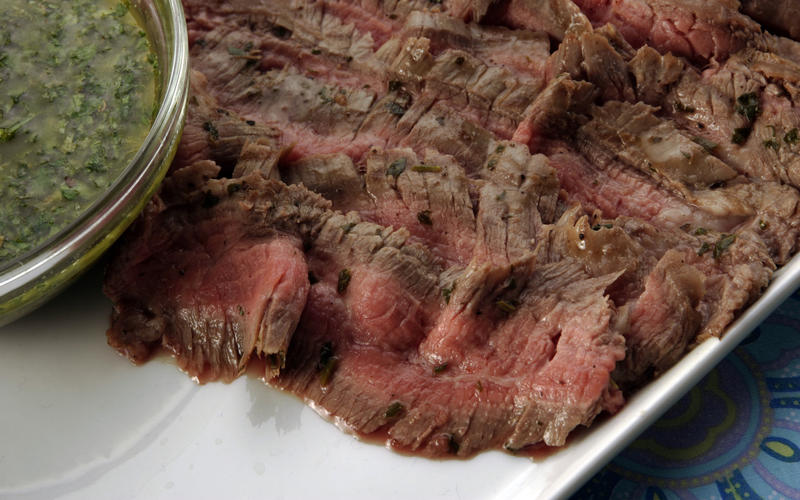 Grilled flank steaks with chimichurri sauce