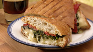 Green panini with roasted peppers and Gruyere cheese