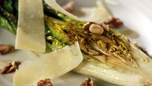 Grilled romaine with walnuts, Parmesan and anchovy dressing