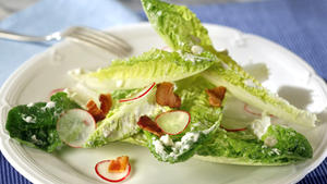 Romaine salad with blue cheese, bacon and radishes
