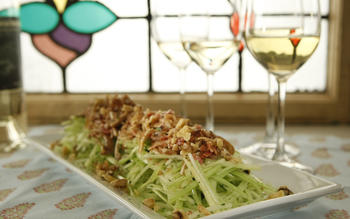 Celery salad with pig ear, bacon and walnuts