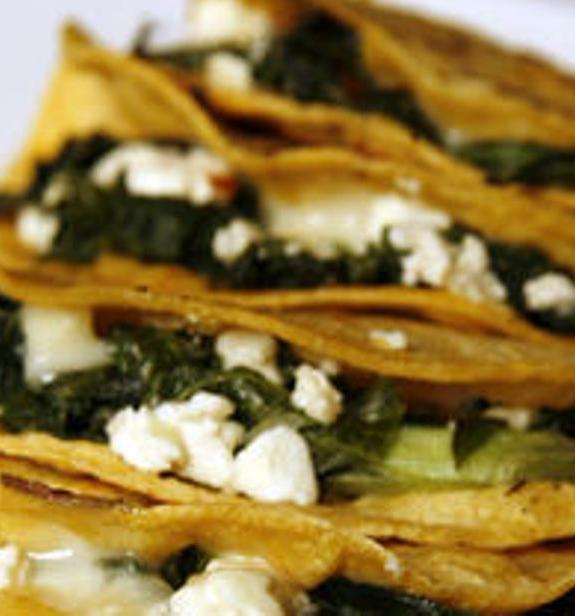 Quesadillas stuffed with greens and feta