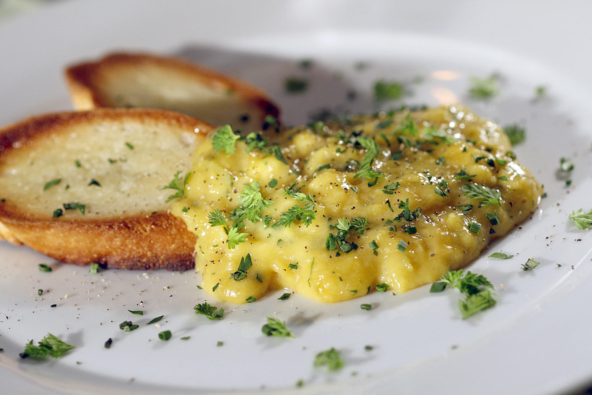 Creamy scrambled eggs with fines herbes