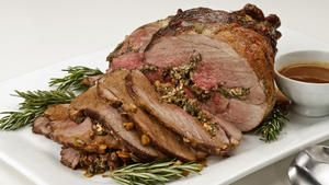 Leg of lamb stuffed with greens, feta and pine nuts