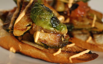 Firefly Bistro's sauteed Brussels sprouts with charred tomato and smoked paprika creme