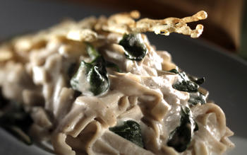 Cashew cream fettuccine Alfredo with sauteed spinach and cheese crisps (gluten-free)
