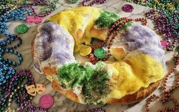 Mardi Gras king cake with cream cheese and apple fillings