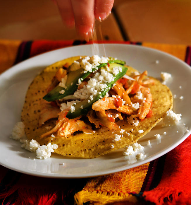 Tinga de pollo (chicken in chipotle-tomato sauce)