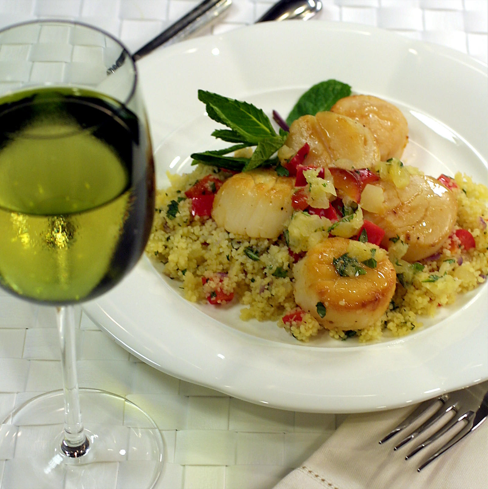Seared scallops with pineapple salsa couscous