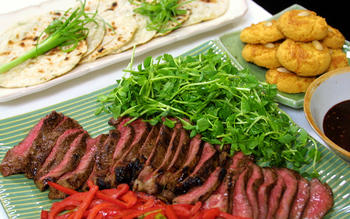 Hoisin-marinated steak in spring onion pancakes