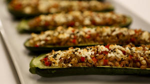 Zucchini stuffed with farro, red pepper and feta
