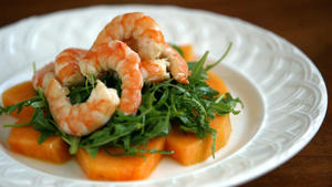 Melon salad with shrimp and wild arugula