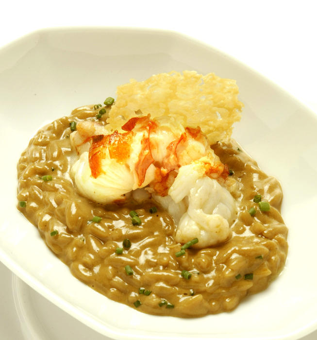 Butter-poached lobster with creamy lobster broth and orzo