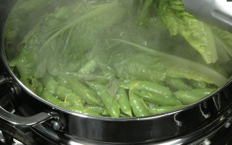 Sugar snap peas steamed in lettuce leaves