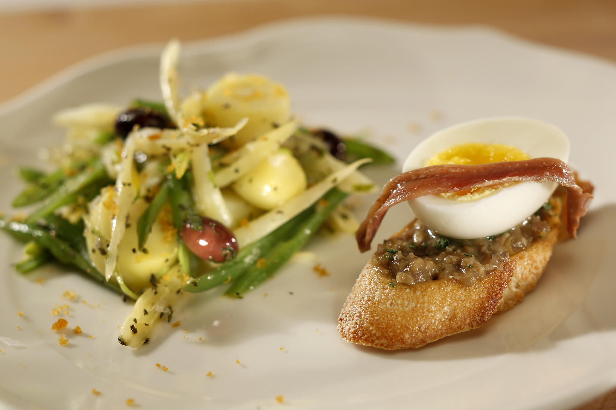 Wax bean Nicoise with bottarga and Cetara anchovy crostone