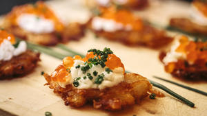 Potato pancakes with fresh whipped lemon cream and salmon eggs