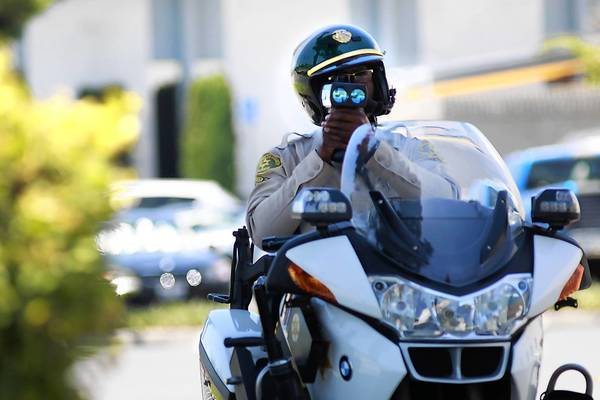 Los Angeles County Sheriff S Deputy Elton Simmons Checks A Motorist Sd In