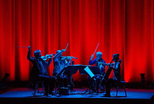 A photo of the Kronos Quartet.
